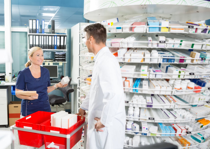 the lady asking the pharmacist about the medicine she's holding